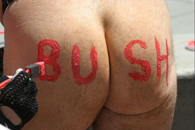 Bush Is A Bum 2 - A participant in the World Naked Bike Ride against oil dependency shows his true feelings toward the president of the United States, Sunday, June 12, 2004.
